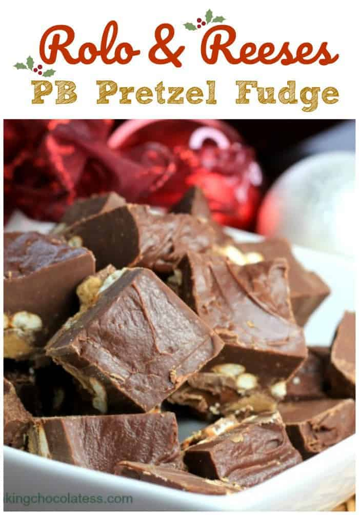 Rolo Reeses PB Pretzel Fudge - An outrageous outburst of Reeses' peanut butter cups, crunchy salted pretzels and caramel Rolos' surrounded in a smooth chocolate fudge on top. #chocolate #fudge #peanut butter #pretzel #reeses #rolo #holiday #sweet and salty