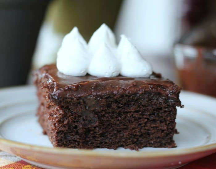 Sinful Triple Chocolate Fudge Poke Cake